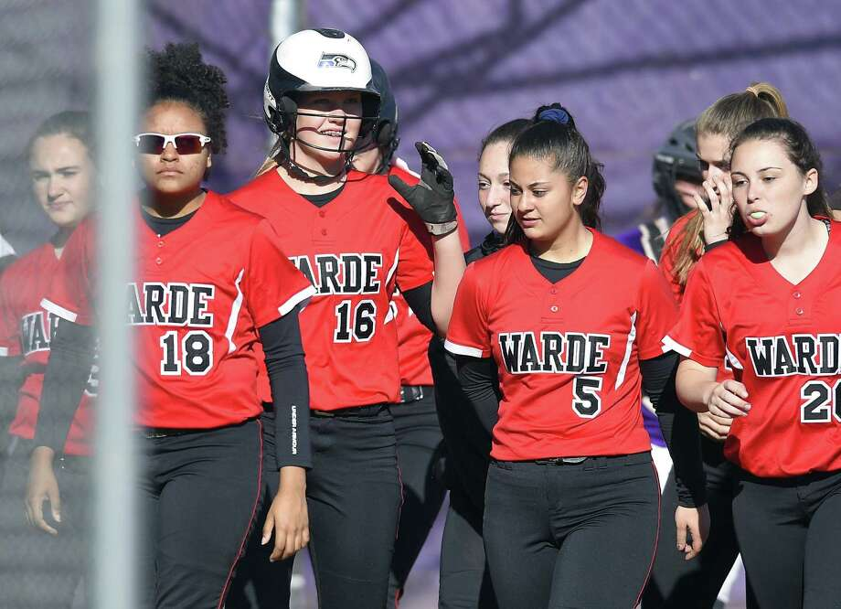 Fairfield Warde Olivia Vadas (16) celebrates with teammates following a sixth inning homerun against Westhill in a FCIAC girls softball game at Westhill High School in Stamford, Conn. on April 20, 2018. Fairfield Warde defeated Westhill 9-4. Photo: Matthew Brown / Hearst Connecticut Media / Stamford Advocate