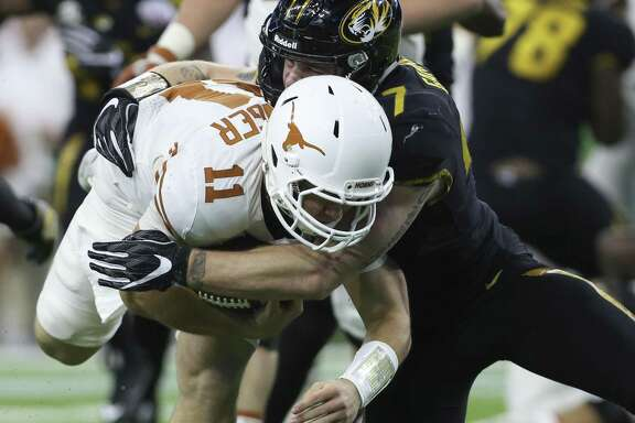 Missouri's Cale Garrett (47) tackles Texas Quarterback Sam Ehlinger (11) in front of the end zone during the first quarter of the 2017 Academy Sports + Outdoors Texas Bowl game at NRG Stadium on Wednesday, Dec. 27, 2017, in Houston. ( Yi-Chin Lee / Houston Chronicle )