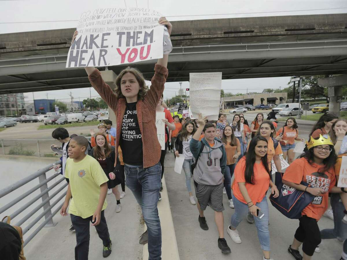 Houston high school students walk out of class during the Houston Youth Walktou, a march to coincide with the anniversary of Columbine High School shooting on Friday, April 20, 2018, in Houston. ( Elizabeth Conley / Houston Chronicle )