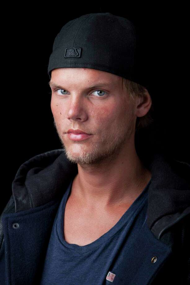 FILE - In this Aug. 30, 2013 file photo, Swedish DJ-producer, Avicii poses for a portrait, in New York. Swedish-born Avicii, whose name is Tim Bergling, was found dead, Friday April 20, 2018, in Muscat, Oman. He was 28. (Photo by Amy Sussman/Invision/AP, File) Photo: Amy Sussman / Invision