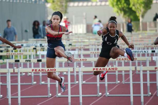 Clear Lake's Alaura Krukoski and Pearland's Jackie Arrington participate in the 100m hurdles at the 23-6A and 24-6A track meet at Pearland High School.