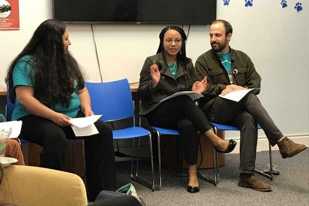 Unidad Latina en Accion organizer Fatima Rojas and Yale Law School students Valerie Comenencia Ortiz and Ricky Zacharias.
