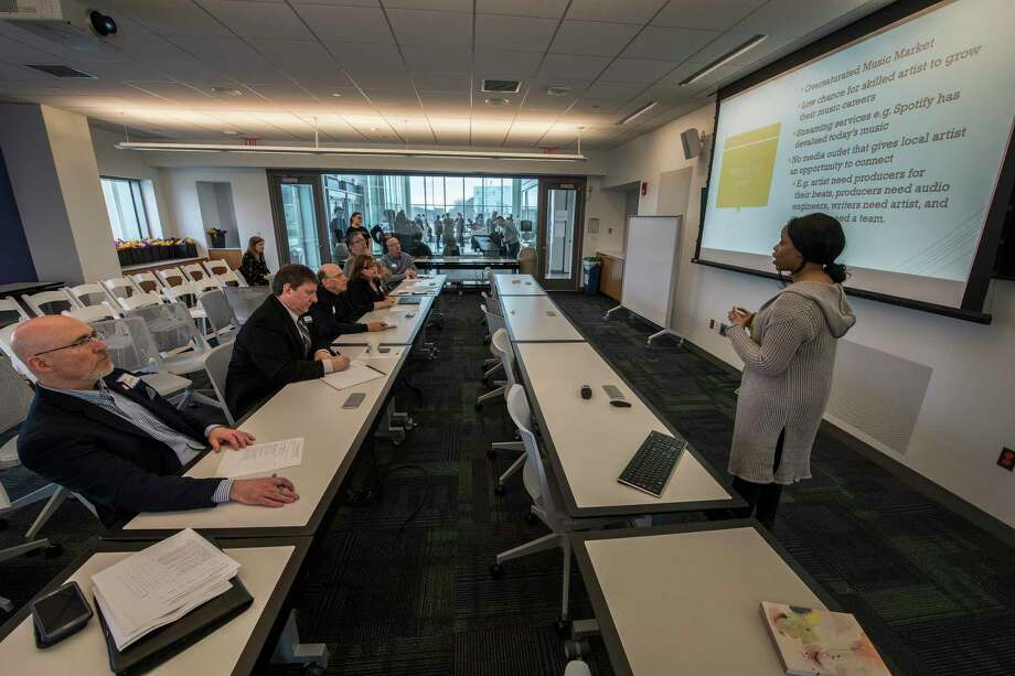 Tasha Taylor, right, gives her presentation for her company, TimelessMusic's business model during the Blackstone Launchpad's Innovation Competition at the University at Albany Friday April 20, 2018 in Albany, N.Y.  (Skip Dickstein/Times Union) Photo: SKIP DICKSTEIN / 40043564A