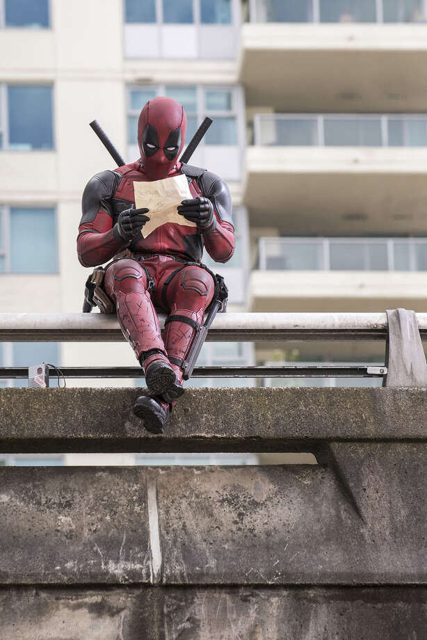 DEADPOOL  Ryan Reynolds as Deadpool relaxes before leaping into battle.  Photo Credit: David Dolsen  TM & © 2015 Marvel & Subs.  TM and © 2015 Twentieth Century Fox Film Corporation.  All rights reserved.  Not for sale or duplication. Photo: David Dolsen / TM & © 2015 Marvel & Subs.  TM and © 2015 Twentieth Century Fox