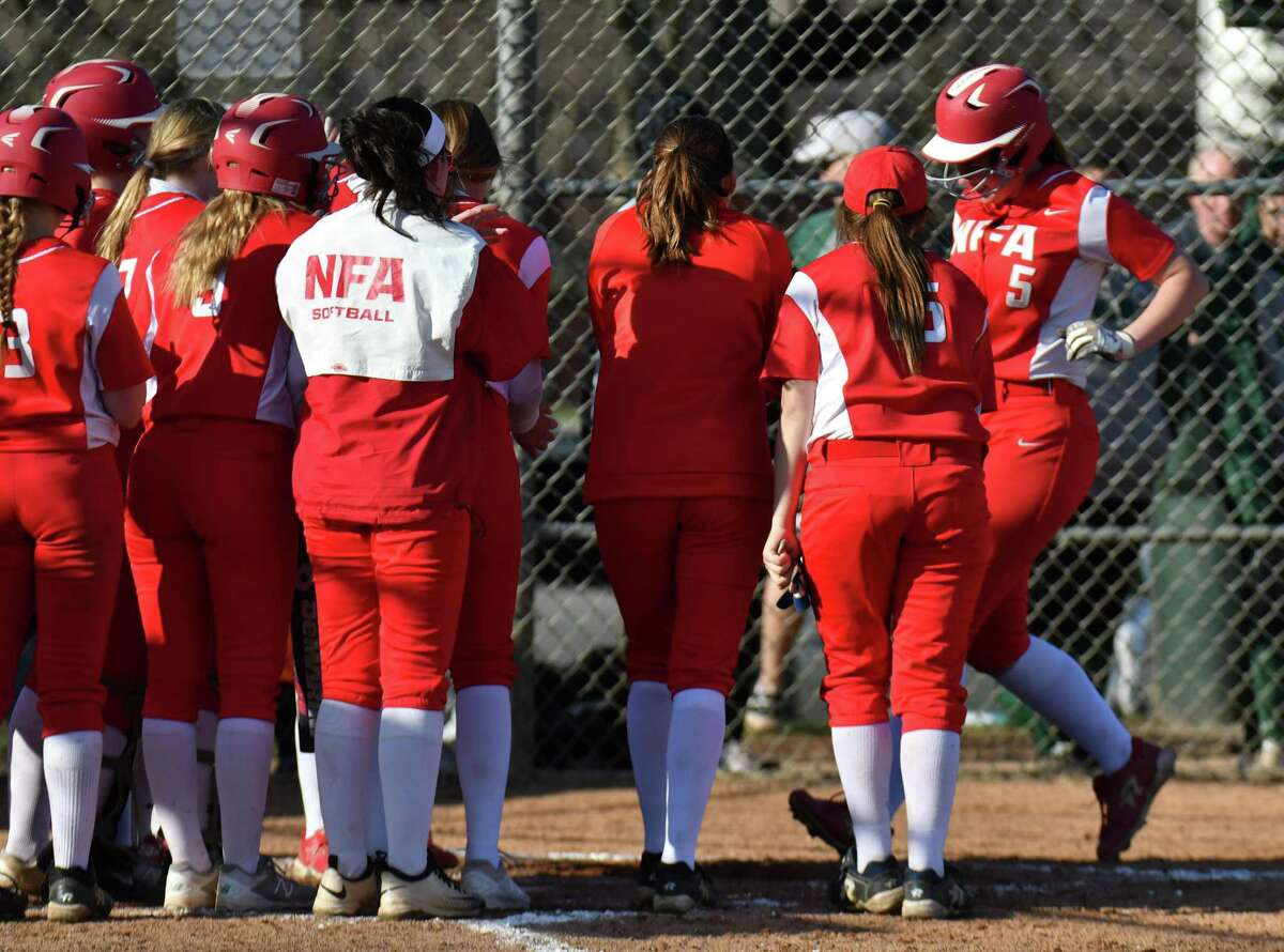 Members of Norwich Free Academy gather at home plate to congratulate Brooke Gottshall after hitting a two run homer during a game against Norwich Free Academy at Norwalk High School on Friday April 20, 2018, in Norwalk, Connecticut.
