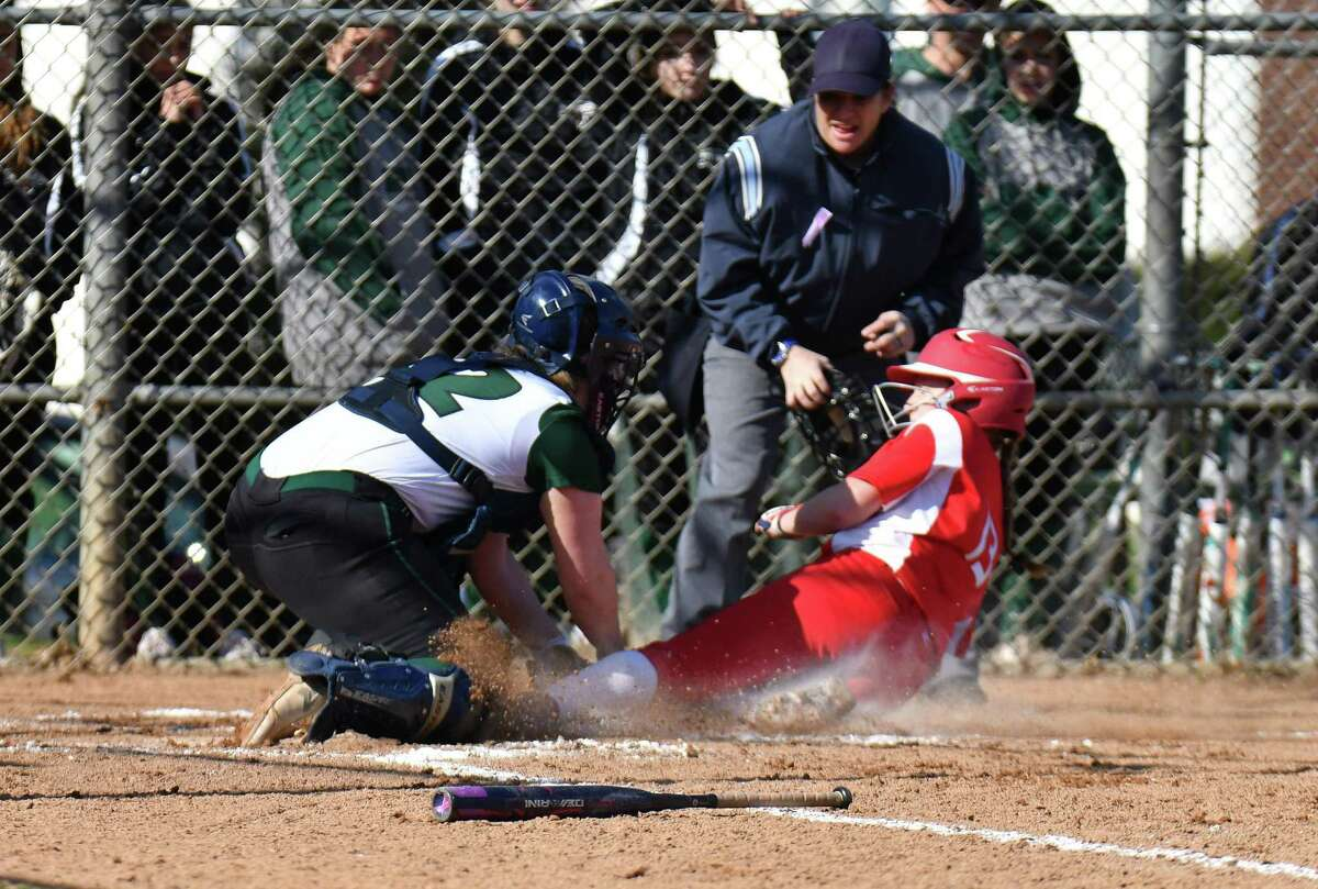 Catcher Dina DiBlasio (12) of the Norwalk Bears tags out Sophia DiCocco (13) of Norwich Free Academy at the plate during a game at Norwalk High School on Friday April 20, 2018, in Norwalk, Connecticut.