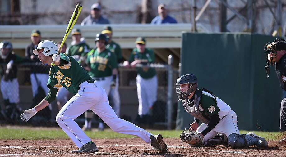 Hamden's Jake Pisano hit two singles and drove in two runs against Notre Dame-West Haven, Friday, April 20, 2018, at Robert Greenwood Memorial Field at Quigley Stadium in West Haven. The Green Dragons won, 7-2. Photo: Catherine Avalone, Hearst Connecticut Media / New Haven Register