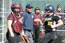 Hand's Caroline O'Connor scores in the sixth inning Friday as Sheehan catcher Carolyn Biel looks on.