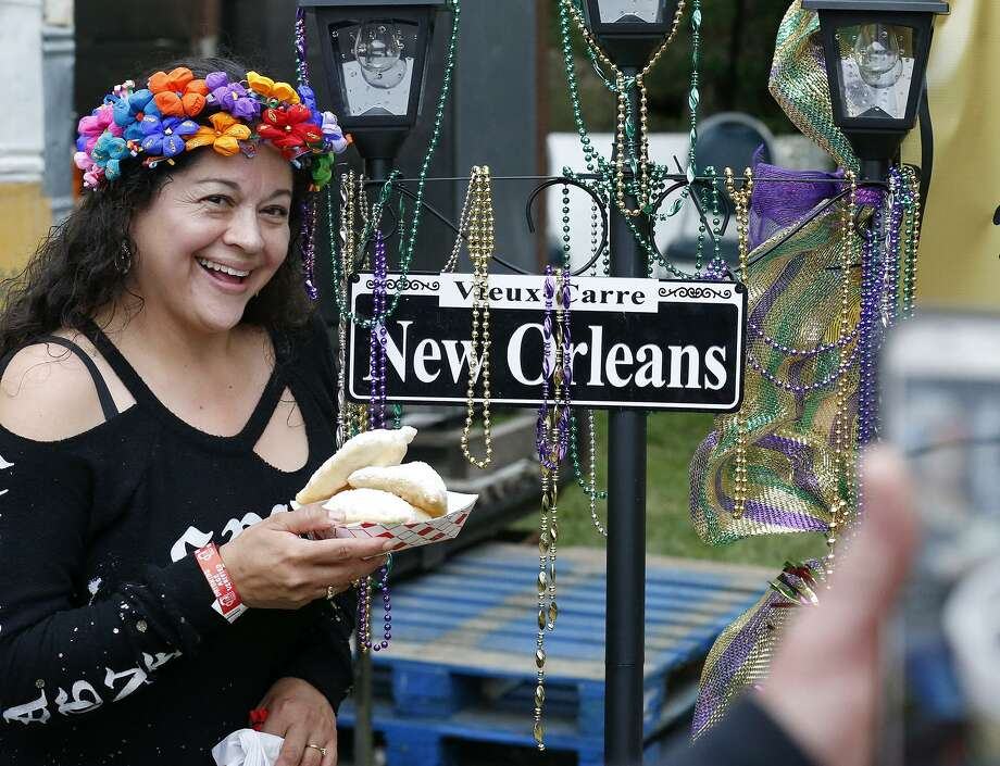 Elvira Rodriguez poses with her beignets during a Taste of New Orleans held Friday April 20, 2018 at Sunken Garden Theater. Photo: Edward A. Ornelas,  Staff / San Antonio Express-News / © 2018 San Antonio Express-News