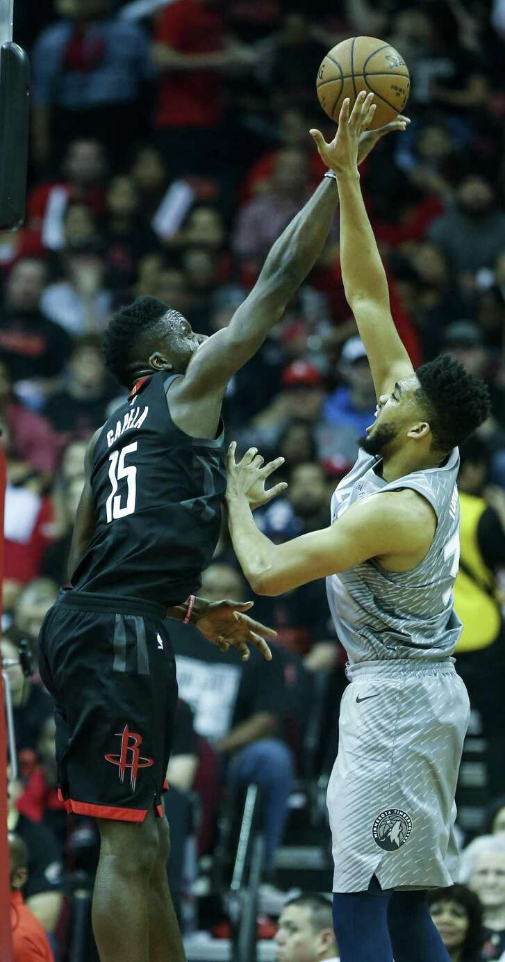 Rockets center Clint Capela (15) blocks a shot by Minnesota Timberwolves center Karl-Anthony Towns (32) during the first quarter of Game 1 of an NBA basketball first-round playoff series at Toyota Center on Sunday, April 15, 2018, in Houston. ( Brett Coomer / Houston Chronicle )