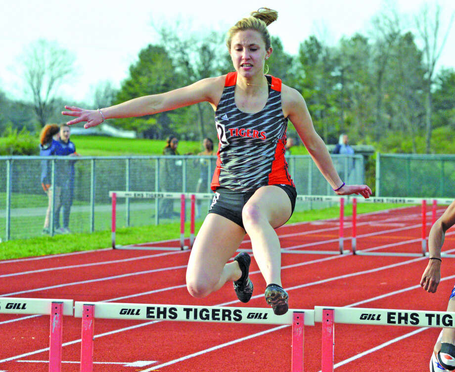 Edwardsville's Elise Krone competes in the 300-meter hurdles during Friday's Tiger Invite at the Winston Brown Track and Field Complex.