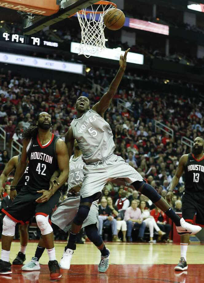 Minnesota's Gorgui Dieng (5), putting a shot up over Nene of the Rockets during Game 1, prays five times a day with the last prayer coming after the final buzzer. Photo: Brett Coomer, Staff / Houston Chronicle / © 2018 Houston Chronicle