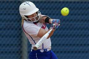 Kenzie Mays #2 of Oak Ridge hits an RBI single to score Rhian Journey during the first inning of a District 12-6A high school softball game, Friday, April 20, 2018, in Shenandoah.
