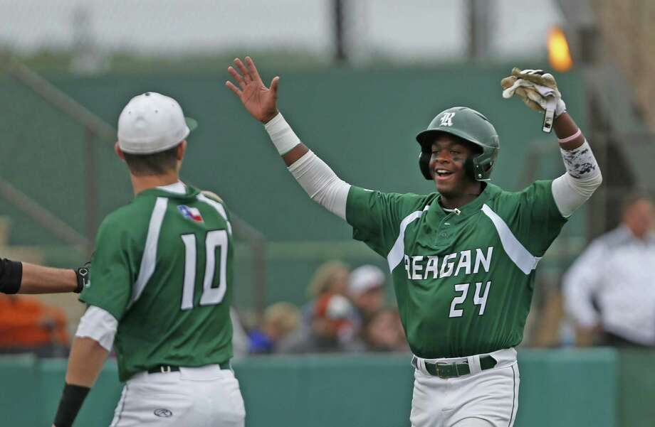 Reagan's Porter Brown,24, celebrates the first run with Ben Sanchez in the first inning from the District 26-6A high school baseball game between Madison and Reagan on Friday, April 20 ,2018 at Blossom Athletic Center. Photo: Ronald Cortes / For The Express-News / 2018 Ronald Cortes