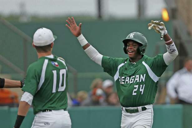 Reagan's Porter Brown,24, celebrates the first run with Ben Sanchez in the first inning from the District 26-6A high school baseball game between Madison and Reagan on Friday, April 20 ,2018 at Blossom Athletic Center.