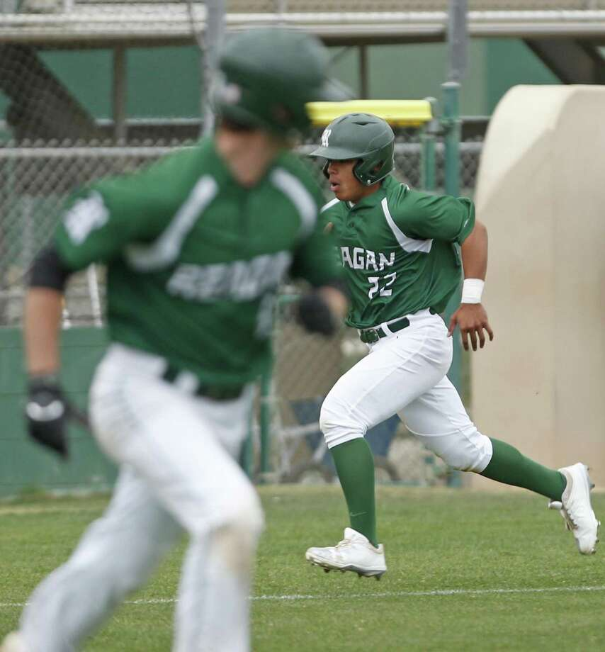 Reagan's Jared Sherer steals home after a wild pitch walked Seth Morrow from the District 26-6A high school baseball game between Madison and Reagan on Friday, April 20 ,2018 at Blossom Athletic Center. Photo: Ronald Cortes, For The San Antonio Express News / 2018 Ronald Cortes