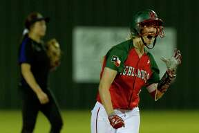 The Woodlands' Amanda Curran (22) reacts hitting a two-run homer in the sixth inning to break a 7-7 tie during a District 12-6A high school softball game against Lufkin, Friday, April 20, 2018, in The Woodlands. The Woodlands went on to win the game and the district title behind Curran's performance at the plate and on the mound.