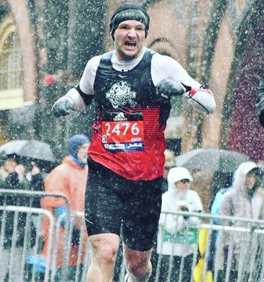 Nick Rochefort battles through terrible conditions near the finish of the Boston Marathon. Photo: Courtesy Photo