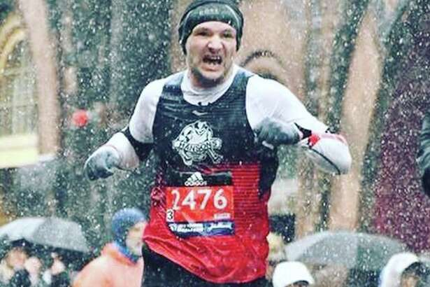 Nick Rochefort battles through terrible conditions near the finish of the Boston Marathon.