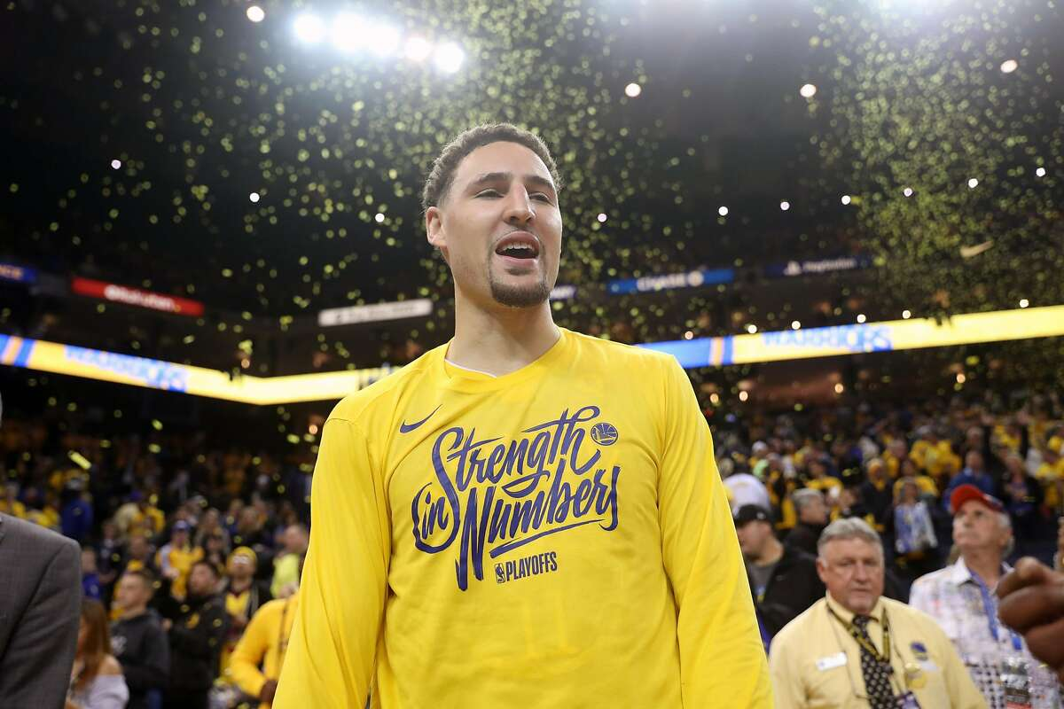 Golden State Warriors' Klay Thompson celebrates after Warriors' 116-101 win over San Antonio Spurs in Game 2 of NBA Western Conference First Round playoffs at Oracle Arena in Oakland, Calif., on Monday, April 16, 2018.