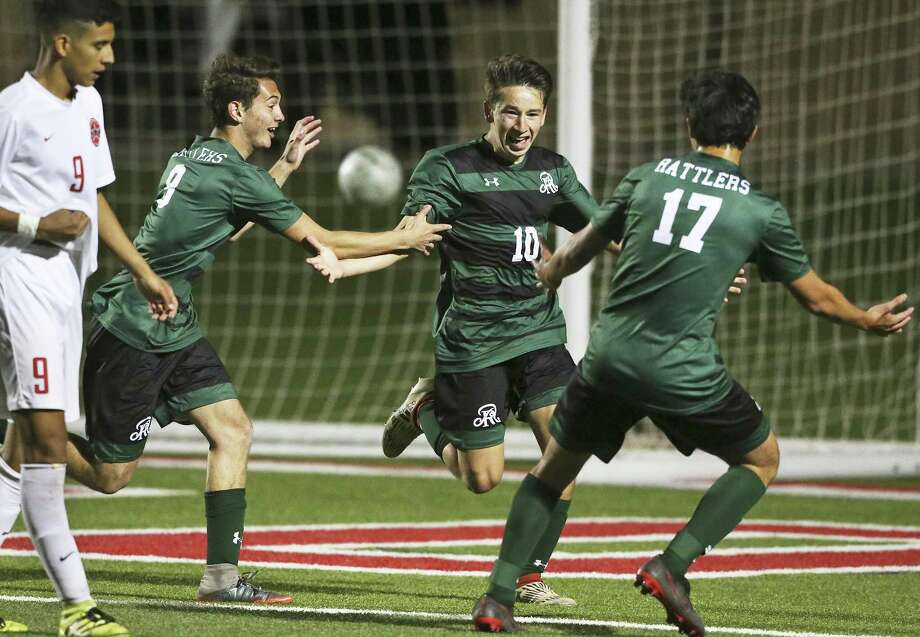 Santi De La Torre runs out to celebrate with teammates after scoring his second goal as Reagan defeats Coppell 3-1 in the UIL Class 6A state semifinal boys soccer match at Birkelbach Field   in Georgetown on April 20, 2018. Photo: Tom Reel, Staff / San Antonio Express-News / 2017 SAN ANTONIO EXPRESS-NEWS