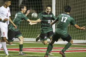 Santi De La Torre runs out to celebrate with teammates after scoring his second goal as Reagan defeats Coppell 3-1 in the UIL Class 6A state semifinal boys soccer match at Birkelbach Field   in Georgetown on April 20, 2018.