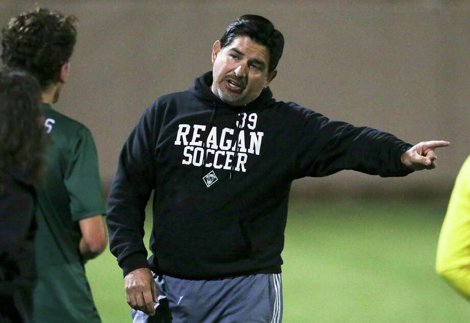 Rattler coach Gilbert Villareal directs a player on the field in the second half as Reagan plays Coppell in the UIL Class 6A state semifinal boys soccer match at Birkelbach Field in Georgetown on April 20, 2018. Photo: Tom Reel, Staff / San Antonio Express-News / 2017 SAN ANTONIO EXPRESS-NEWS