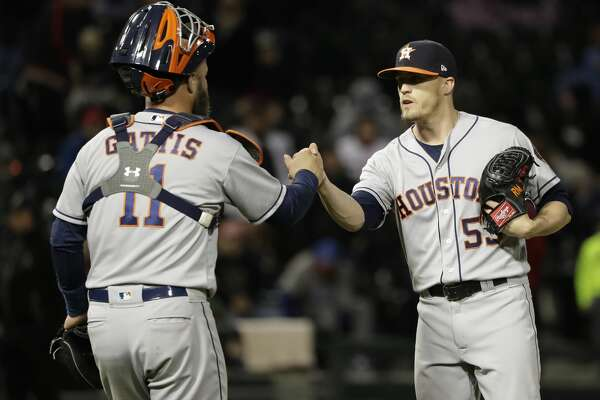 Houston Astros relief pitcher Ken Giles, right, celebrates with catcher Evan Gattis after they defeated the Chicago White Sox in a baseball game Friday, April 20, 2018, in Chicago. (AP Photo/Nam Y. Huh)