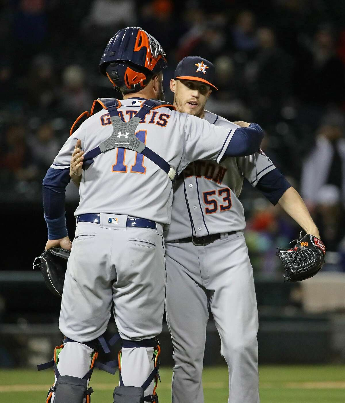 CHICAGO, IL - APRIL 20: Evan Gattis #11 and Ken Giles #53 of the Houston Astros celebrate a win over the Chicago White Sox at Guaranteed Rate Field on April 20, 2018 in Chicago, Illinois.The Astros defeated the White Sox 10-0. (Photo by Jonathan Daniel/Getty Images)