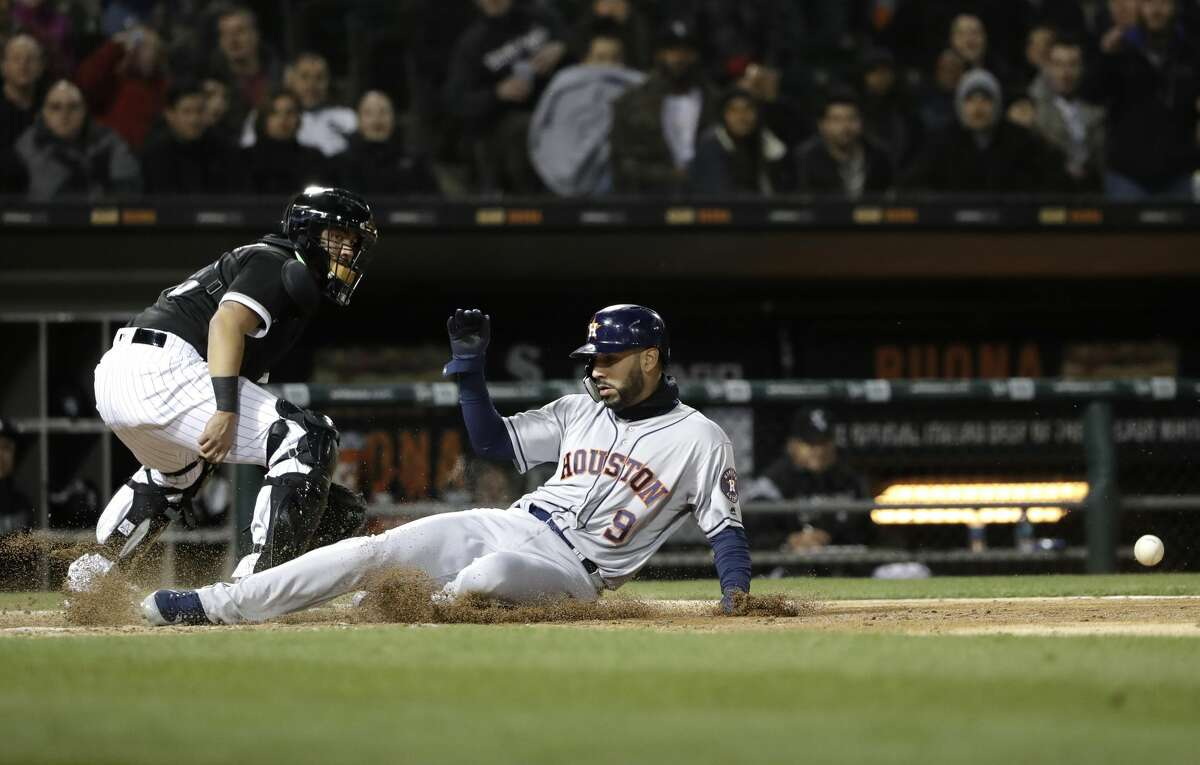 Houston Astros' Marwin Gonzalez, right, scores on a double by George Springer as Chicago White Sox catcher Omar Narvaez looks at ball during the fourth inning of a baseball game Friday, April 20, 2018, in Chicago. (AP Photo/Nam Y. Huh)