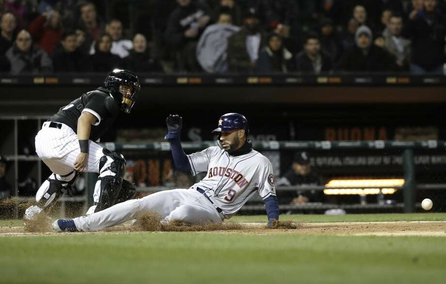 Houston Astros' Marwin Gonzalez, right, scores on a double by George Springer as Chicago White Sox catcher Omar Narvaez looks at ball during the fourth inning of a baseball game Friday, April 20, 2018, in Chicago. (AP Photo/Nam Y. Huh) Photo: Nam Y. Huh/Associated Press