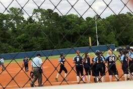Kingwood's Jourdyn Campbell approaches home plate and her awaiting teammates after her second inning home run in a game against King at Kingwood High School on April 20.