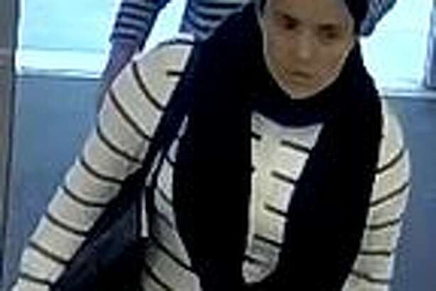 The woman in these photos is accused of convincing an elderly woman to give her a ride to a lottery office and stealing her cash.