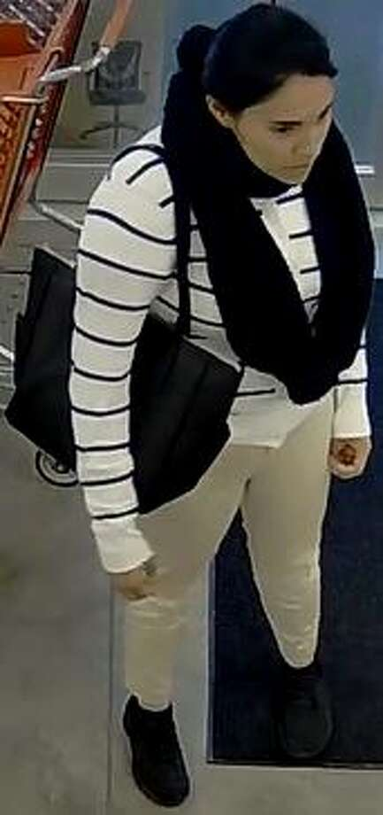 The woman in these photos is accused of convincing an elderly woman to give her a ride to a lottery office and stealing her cash. Photo: Bexar County Sheriff