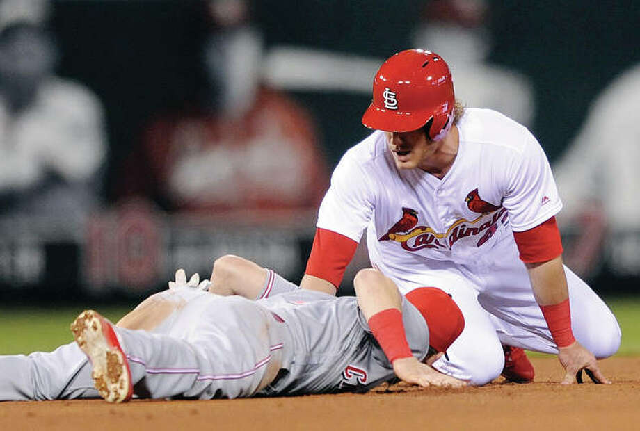 The Cardinals' Harrison Bader, right, steals second sliding past the Reds' Scooter Gennett, left, in the third inning Friday night at Busch Stadium in St. Louis. Photo:       AP
