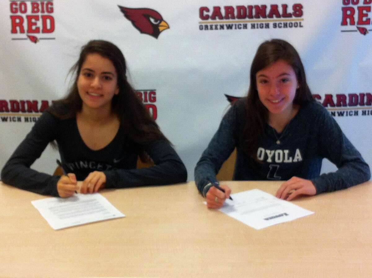 Greenwich High School seniors Emily Philippides, left, and Kate Ragone will each continue their track and field careers in college. Philippides will compete at Princeton University and Ragone will join the track team at Loyola Maryland University. Joining them at Friday?'s college announcement ceremony was Greenwich High girls track and field coach Evan Dubin. April 20, 2018