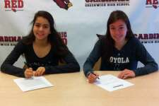 Greenwich High School seniors Emily Philippides, left, and Kate Ragone will each continue their track and field careers in college. Philippides will compete at Princeton University and Ragone will join the track team at Loyola Maryland University. Joining them at Friday's college announcement ceremony was Greenwich High girls track and field coach Evan Dubin. April 20, 2018