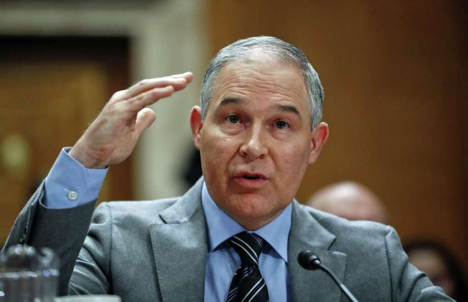 In this Jan. 30, 2018, photo, Environmental Protection Agency administrator Scott Pruitt testifies before the Senate Environment Committee on Capitol Hill in Washington. Newly released emails show Pruitt personally monitored efforts last year to excise much of the information about climate change from the agency's website, especially President Obama's signature effort to reduce planet-warming carbon emissions from coal-fired power plants.  (AP Photo/Pablo Martinez Monsivais) Photo: Pablo Martinez Monsivais, STF / Associated Press / Copyright 2018 The Associated Press. All rights reserved.