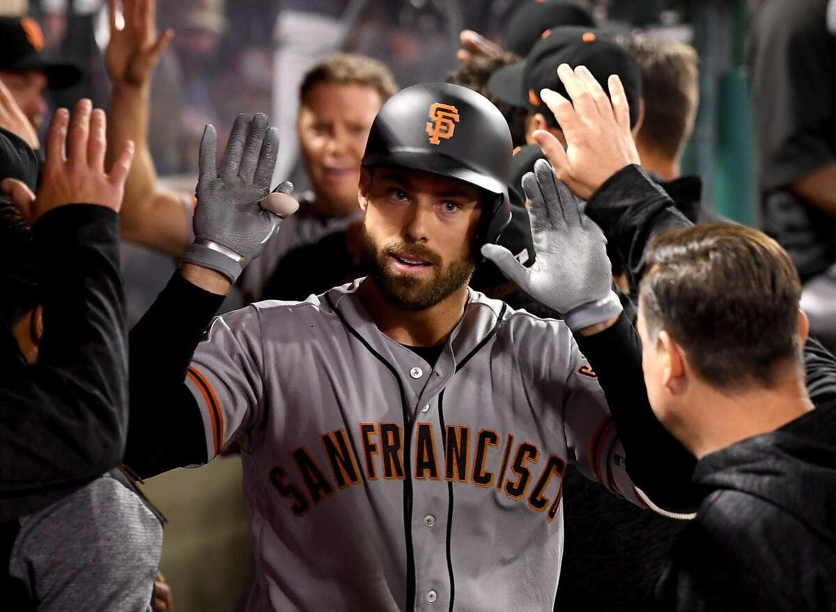 Mac Williamson #51 of the San Francisco Giants is greeted in the dugout after a two run home in the fifth inning of the game against the Los Angeles Angels of Anaheim at Angel Stadium of Anaheim on April 20, 2018 in Anaheim, California.