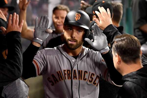 ANAHEIM, CA - APRIL 20:  Mac Williamson #51 of the San Francisco Giants is greeted in the dugout after a two run home in the fifth inning of the game against the Los Angeles Angels of Anaheim at Angel Stadium of Anaheim on April 20, 2018 in Anaheim, California.  (Photo by Jayne Kamin-Oncea/Getty Images)