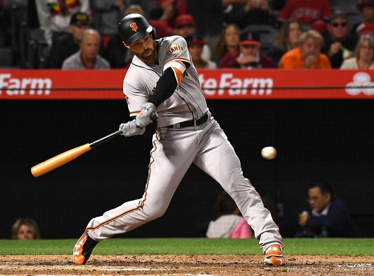 Mac Williamson #51 of the San Francisco Giants hits a two run home in the fifth inning of the game against the Los Angeles Angels of Anaheim at Angel Stadium of Anaheim on April 20, 2018 in Anaheim, California.