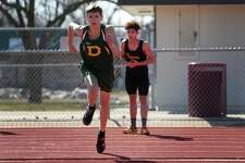 Dow's Garrett Daniels goes for his approach at high jump during the Graves/Swayze Relays at Midland High School on April 20, 2018. (Samantha Madar for the Daily News)