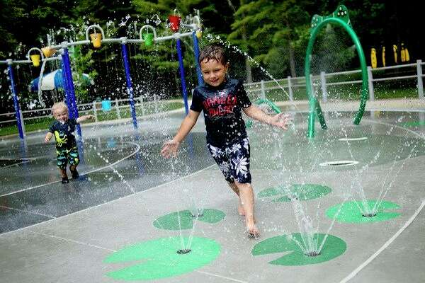 Daily News file photo 				Thomas Peistrack, right, 4, and his brother Samuel, 2, both of Standish, play in the spray park at Sanford Lake Park.