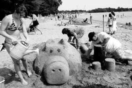 Daily News file photo TyLynn Smith, left, her mother, Shelley Smith and Ron Schweigert work on finishing their sand sculpture Sunday afternoon. The sand castle competition was put on by Hangtime Sports as part of the 5th Annual Parkapalooza at Sanford Lake Park.
