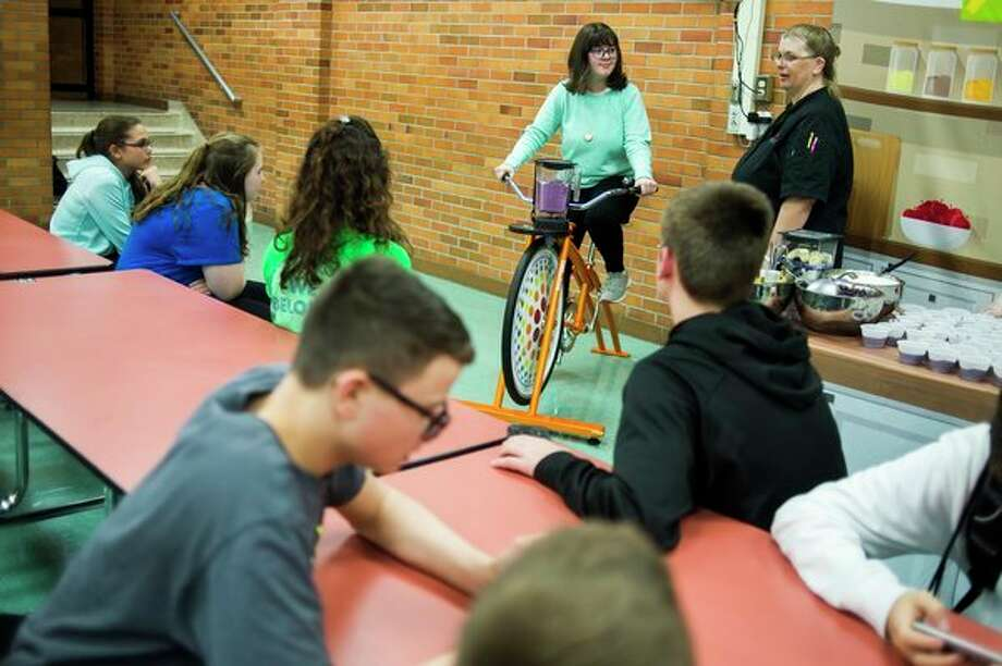 Jessica Salminen, 14, rides a stationary bike that powers a blender making a smoothie on Wednesday during The ROCK after school program at Jefferson Middle School. (Katy Kildee/kkildee@mdn.net)