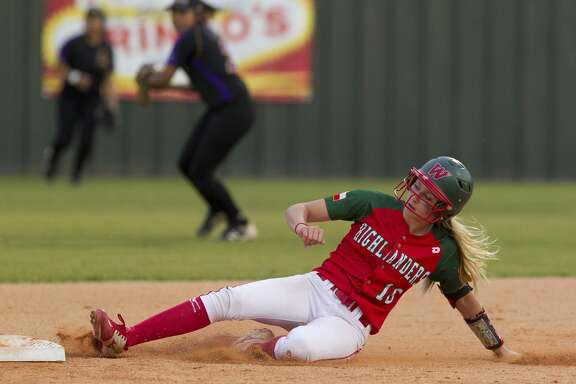 The Woodlands' Skylar Sirdashney (16) slides into second for a doubple during the third inning of a District 12-6A high school softball game, Friday, April 20, 2018, in The Woodlands.