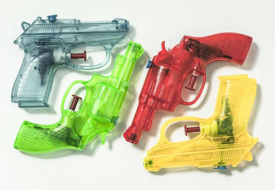 FILE PHOTO: A group of colouful plastic water pistols. Photo: Jonathan Kitchen/Getty Images