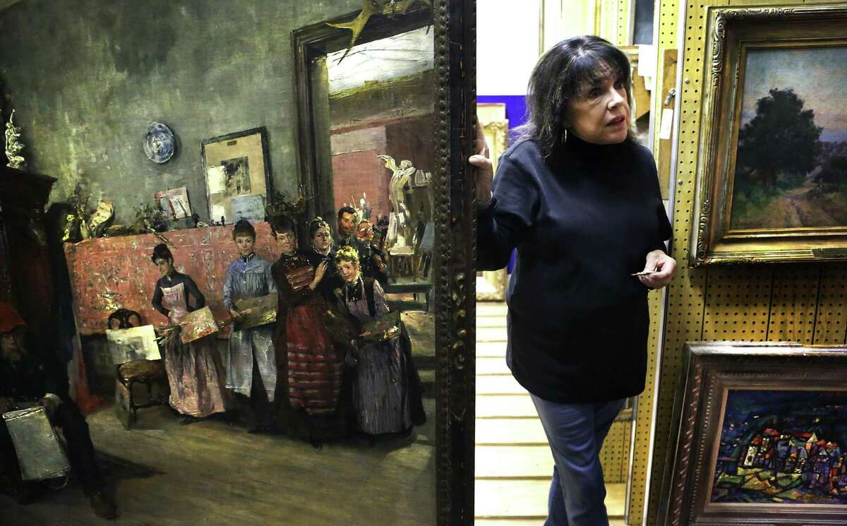 """Lyn Belisle Kurtin, president of San Antonio Art League & Museum, shows William M. Chase's """"Duvenck in his Studio"""" painted in 1878, which is in the San Antonio Art League's & Museum's collection."""