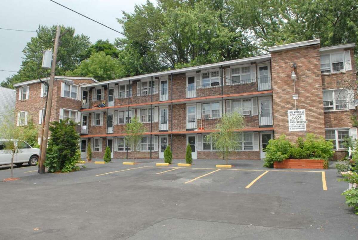 A view of an apartment complex at 105 Morris St. in Albany. The city?s Board of Zoning Appeals has declared three apartment buildings owned by Roger Ploof nuisances and has given the landlord six months to reduce 40 apartments to just six. (Paul Buckowski / Times Union)