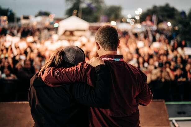 In front of hundreds gathered for an evening of music at the opening night of Oyster Bake, Tyler Walthall proposed to his now fiance Amanda Martinez, Friday, April 20, 2018.